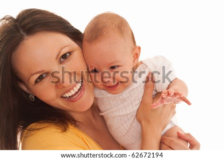 happy mother in yellow holding beautiful newborn