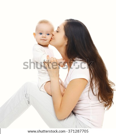 Happy mother kissing her baby on a white background - stock photo