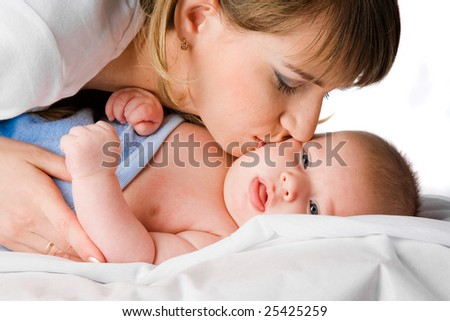 happy mother kissing her little child - stock photo