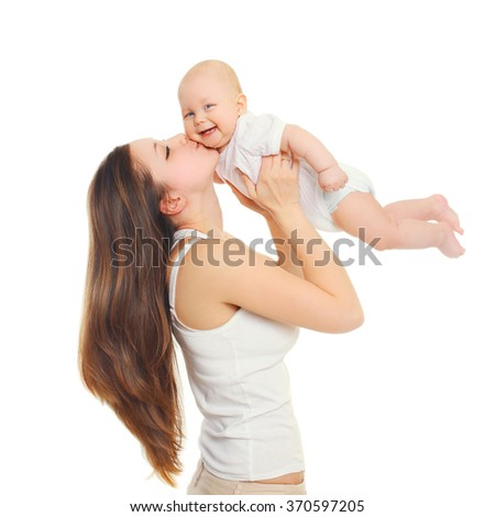 Happy mother playing kissing baby on white background - stock photo