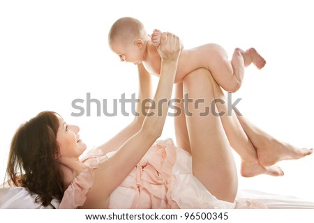 Happy mother playing with baby over white - stock photo