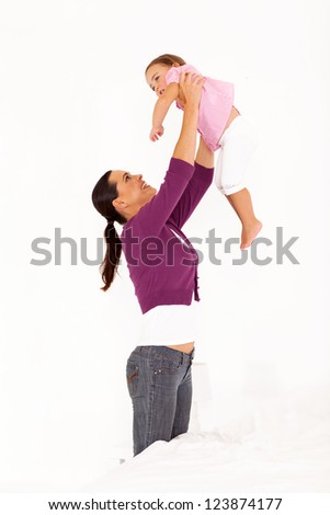 happy mother playing with daughter at home
