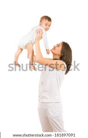 Happy mother playing with her baby boy and being in motion isolated on white background - stock photo