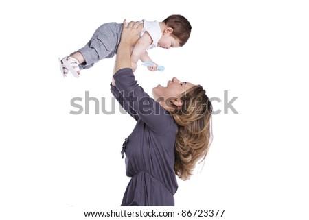 Happy mother playing with her baby son (isolated on white) - stock photo