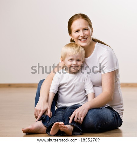 Happy mother posing with son