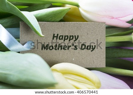 Happy Mother's day card among tulips. - stock photo