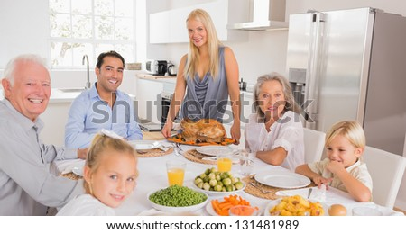 Happy mother serving a turkey for thanksgiving - stock photo