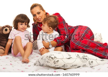 Happy mother standing in bed with her kids - stock photo