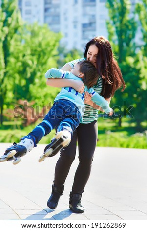 Happy mother twirling her son - stock photo