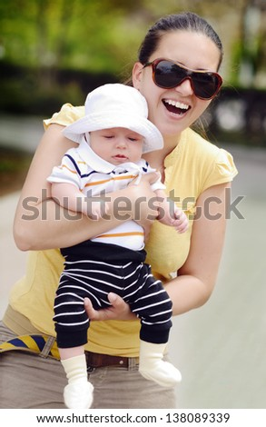 happy mother walking  with baby son - stock photo