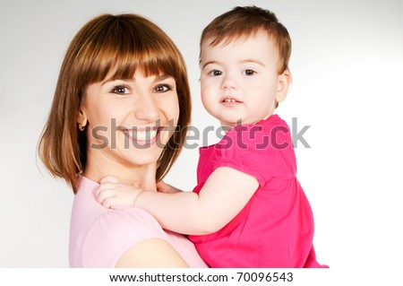 happy mother with a baby on a white background