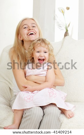 Happy mother with a daughter at home