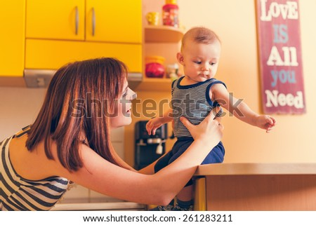 Happy Mother With Adorable Baby Boy Having Fun Indoors - stock photo