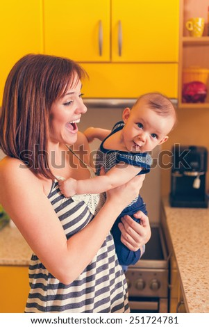 Happy Mother With Adorable Baby Boy Indoors - stock photo