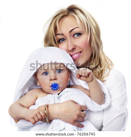 happy mother with baby boy. Focus mostly on child.