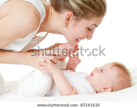 happy mother with baby over white - stock photo
