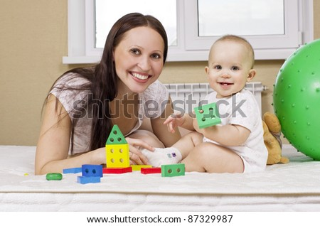 happy mother with baby playing