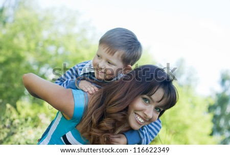 Happy mother with boy together outdoor - stock photo