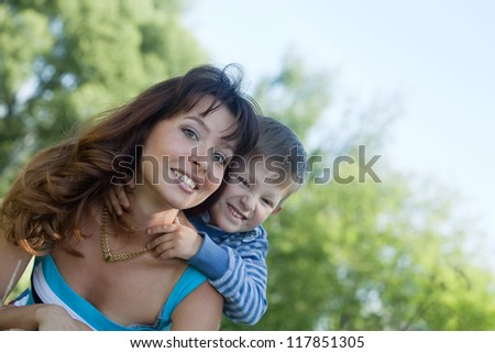 Happy mother with boy together outdoor