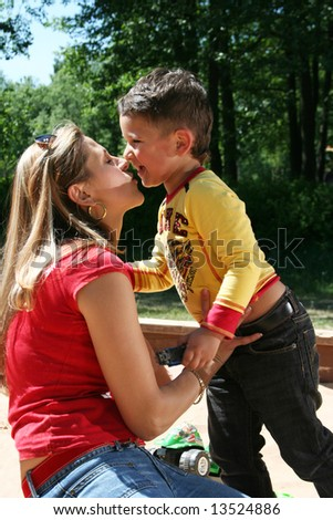 happy mother with charming son - stock photo