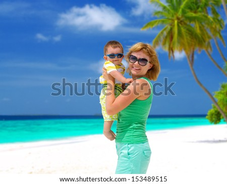 Happy mother with cute baby boy having tropical vacation on Maldives - stock photo