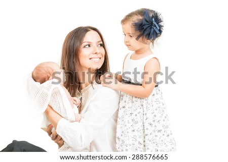 Happy mother with daughter and newborn baby  isolated - stock photo