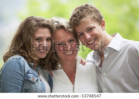 happy mother with daughter and son - stock photo