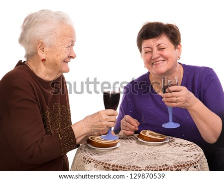 Happy mother with daughter drinking wine on a white background - stock photo