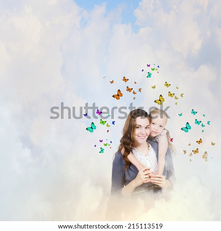 Happy mother with daughter sitting on clouds - stock photo