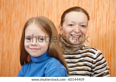 happy mother with her adorable little daughter - stock photo