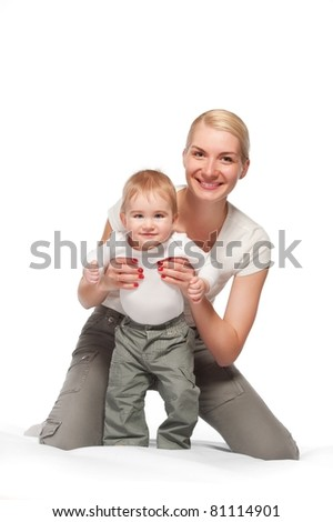 Happy mother with her baby - stock photo