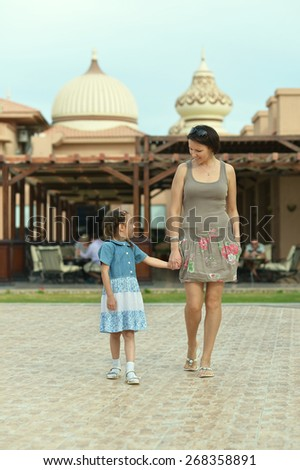 Happy mother with her daughter in summer park - stock photo