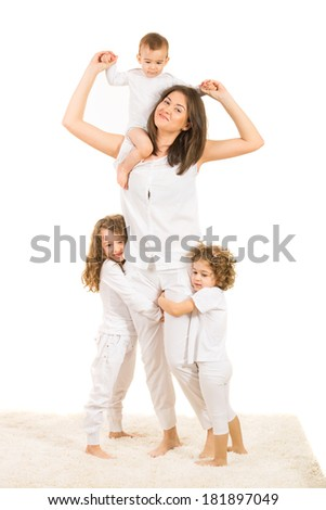 Happy mother with her kids playing home and standing on carpet against white background - stock photo