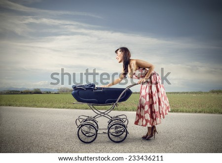 Happy mother with her little baby  - stock photo