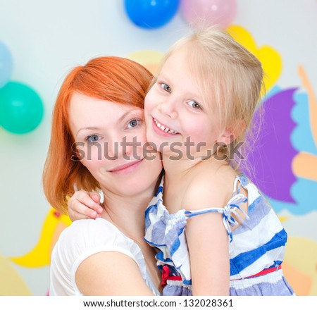 Happy mother with her smiling daughter - stock photo