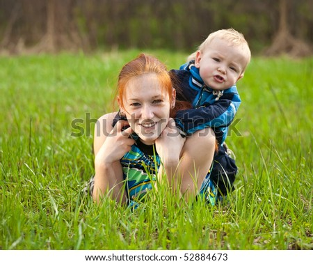 Happy mother with her son on meadow