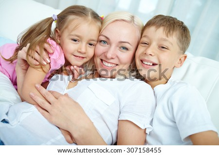 Happy mother with her two children - stock photo