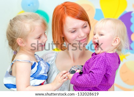 Happy mother with her two daughters - stock photo