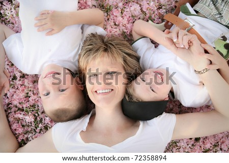 Happy Mother with her Two Happy Boys - stock photo