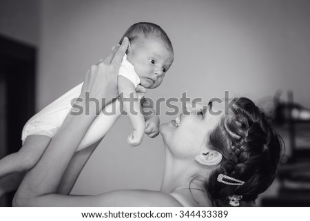 happy mother with newborn baby, black and white - stock photo