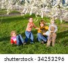 Happy mother with small children in spring recreation ground - stock photo