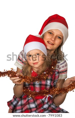 Happy mother with small daughter before the Christmas (isolated on white)