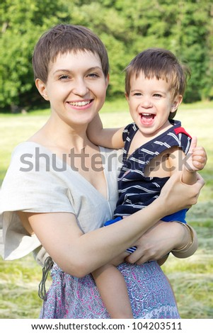 happy mother with son outdoor - stock photo