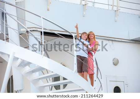 Happy mother with son travel on cruise ship - stock photo