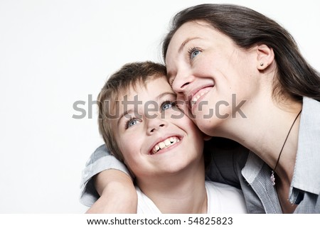 Happy mother with the son isolated on light background - stock photo