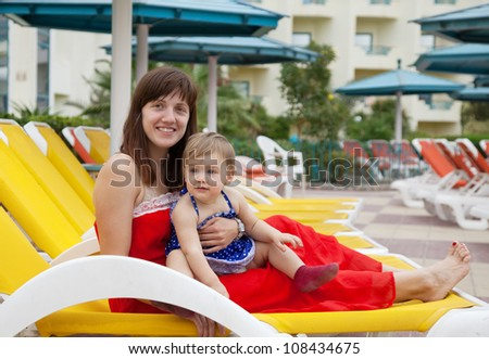 happy mother with  toddler   at resort hotel area