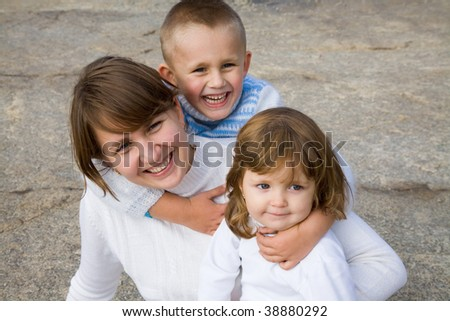 Happy mother with two small children - stock photo