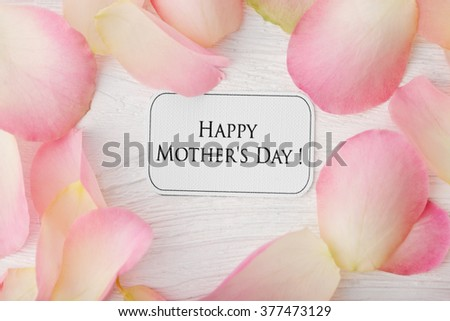happy mothers day card with rose petals - stock photo