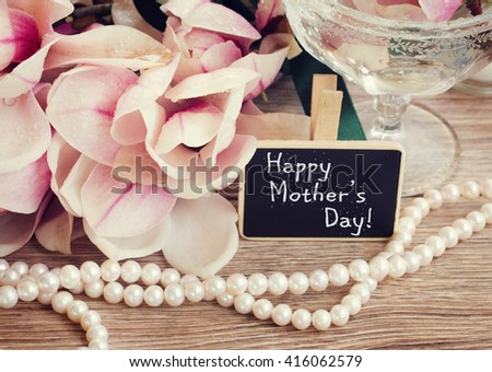 happy mothers day  greetings  - magnolia flowers and pearls strands  - stock photo