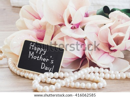 happy mothers day   - magnolia flowers and pearls  - stock photo